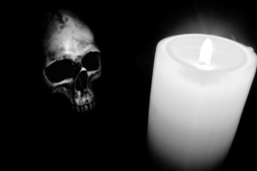 Haunted evening candle and skull