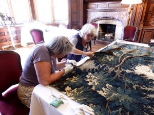 textile conservation - repairing tapestry